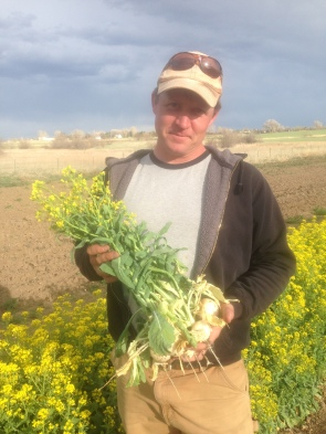 Wyatt holding flowering turnips